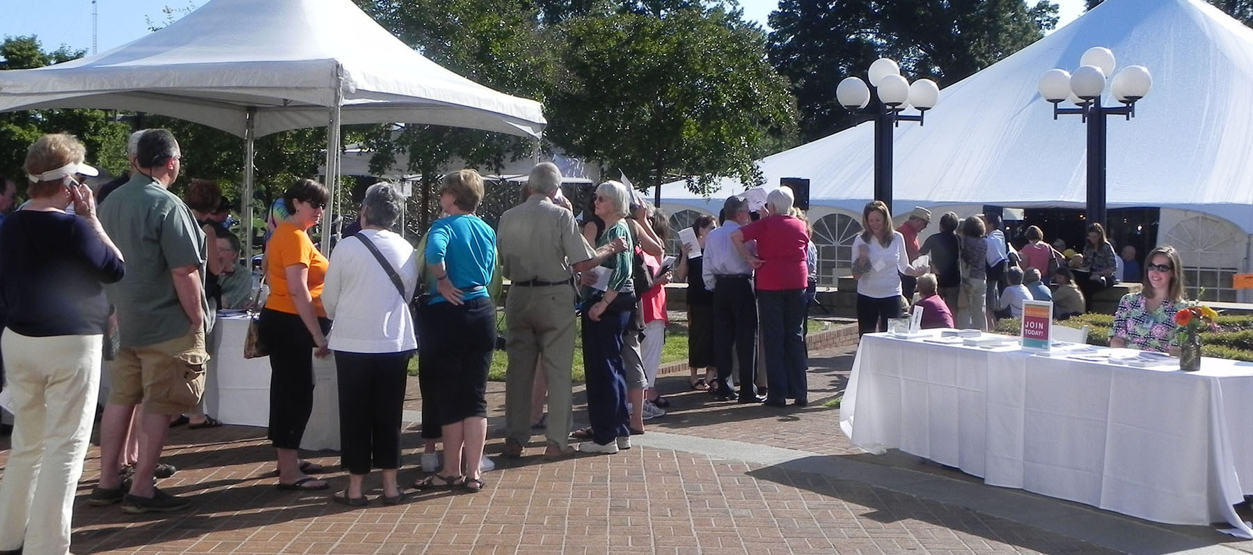 A crowd at the Potters Market Invitational. There are large tents set up on Mint Museum Randolph's lawn to host the event