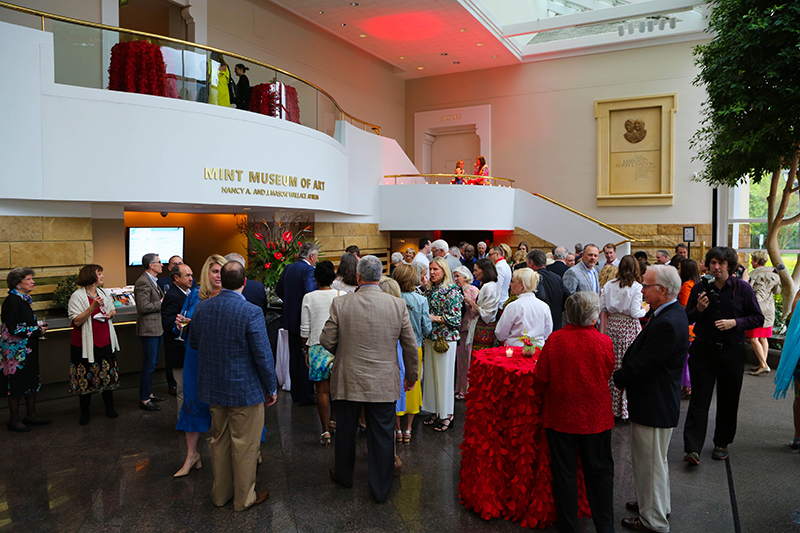 Crown Society gathering in the atrium of Mint Museum Randolph