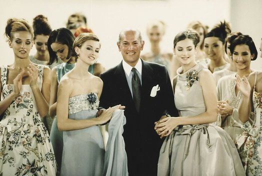 Designer Oscar De La Renta Poses with Models
