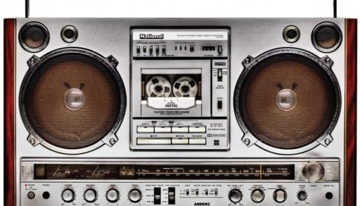 A boombox with a cassette player in the front