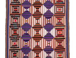 A quilt with diamond shaped patterns across it.
