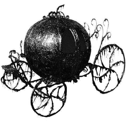 A classic horse drawn carriage that has been covered in an ink-like substance