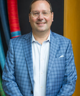 Mint Museum CEO Todd Herman wearing a plaid blazer