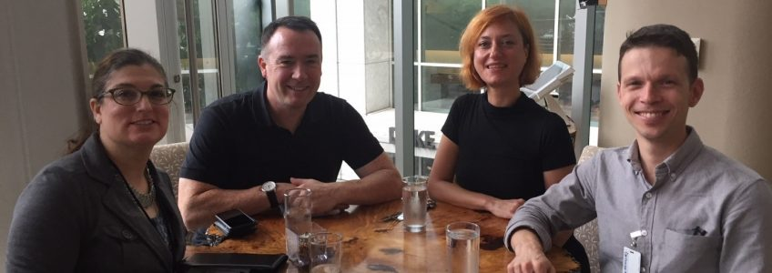 Four people, including the artist Vesna Petresin, sitting around a table at Halcyon, Flavors from the Earth.