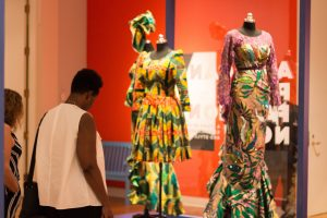 Woman standing in the African-Print Fashion Now! exhibition