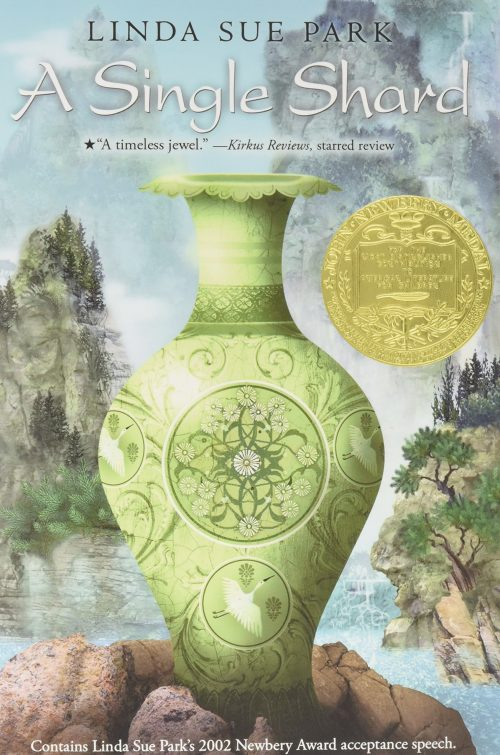 'A single shard' book cover. Pictured is a vase sitting in front of a landscape of a lake and trees.