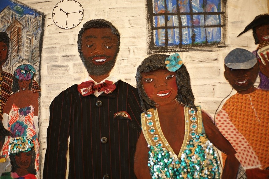 Collage by Nellie Ashford. Two people smiling. Constructed from recycled materials.