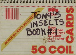 "A spiral bound book with the words ""tony's insects book #1"" written in marker"