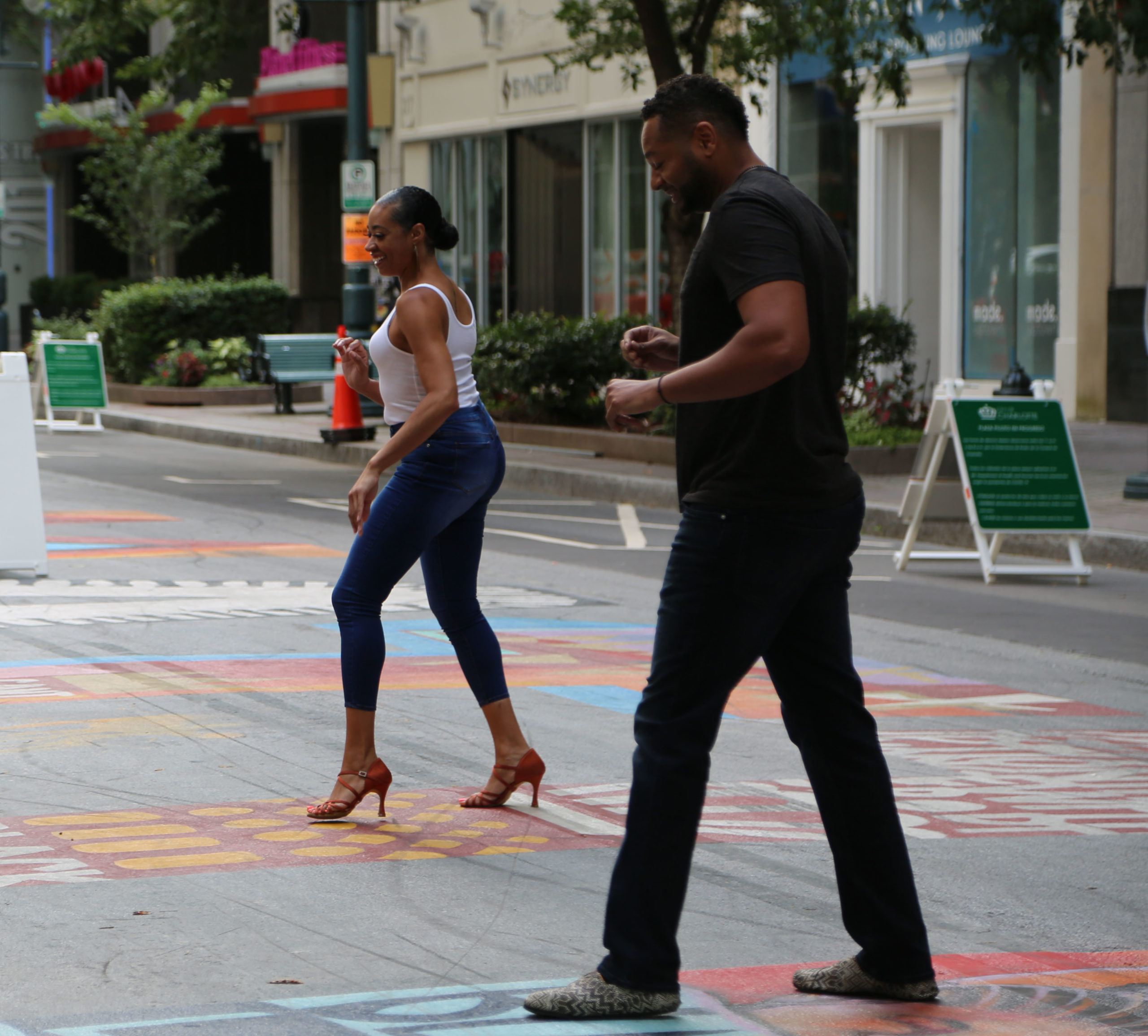 Mint to Move instructors lead a virtual dance lesson on the Black Lives Matter mural in uptown. September 2020.