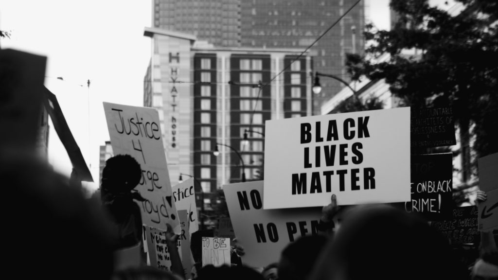 Black Lives Matter sign held above a crowd of protestors in Uptown Charlotte. Photo by Casey Hendrickson.