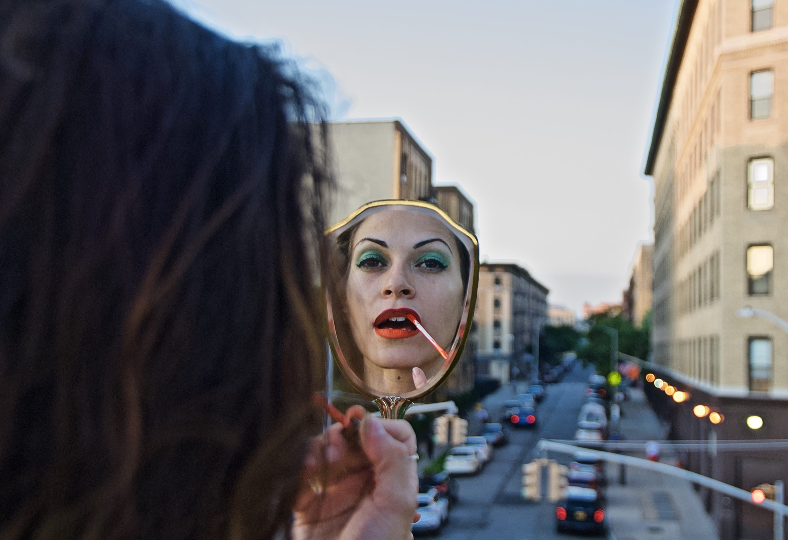 Grandma's Mirror ll (Jennifer looking down from the street she grew up at) 2019, Crotona Park, Bronx, NYC. Friday, August 30, 2019, 7:23 PM (74 degrees). © Ruben Natal-San Miguel. Courtesy of Ruben Natal-San Miguel & Postmasters Gallery.