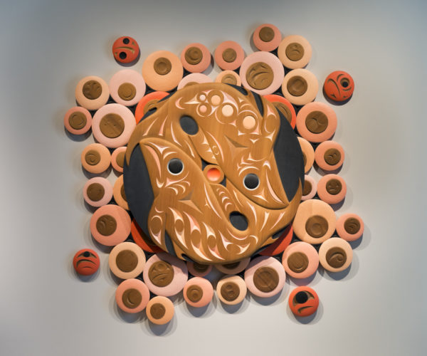 Susan Point (Canadian, Coast Salish, Musqueam First Nation, 1952–). Salmon Spawning Run, 2012, Western red cedar, paint. Project Ten Ten Ten commission. Museum Purchase: Funds provided by Fleur Bresler, Libba and Mike Gaither, Laura and Mike Grace, Betsy and Brian Wilder, Amy and Alfred Dawson, Aida and Greg Saul, Missy Luczak Smith and Doug Smith, Beth and Drew Quartapella, and Kim Blanding. 2012.107A-I. © Susan Point 2012