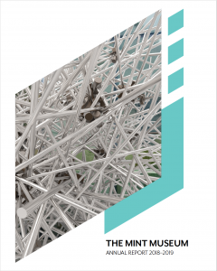 Cover of The Mint Museum's annual report fro 2018-2019. The Mint Diamond logo is cut out from a blank page. Inside the diamond is a close up photo of Thicket, on view at Mint Museum Uptown.