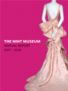 Cover of The Mint Museum's annual report 2017-2018. A mannequin in a pale pink gown stands in front of a hot pink background.