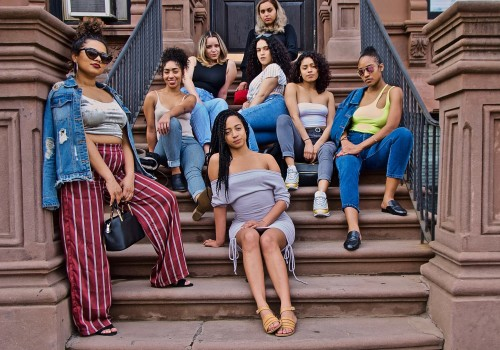 Gurls From The Hood Sitting On The Stoop, (Landlords, Lenox Avenue, Harlem, NYC. Saturday April 13, 2019, 4:54 PM, (76 degrees). © Ruben Natal-San Miguel. Courtesy of Ruben Natal-San Miguel & Postmasters Gallery.