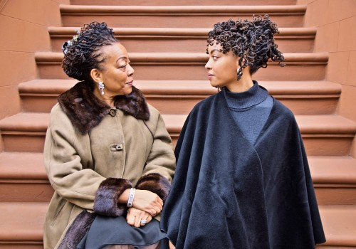 The Stoop Stare Down (Nia & Afiya, Two Generations in Harlem), Harlem, NYC. Sunday, January 26, 2020, 3:30 PM. (42 degrees). © Ruben Natal-San Miguel. Courtesy of Ruben Natal-San Miguel & Postmasters Gallery.